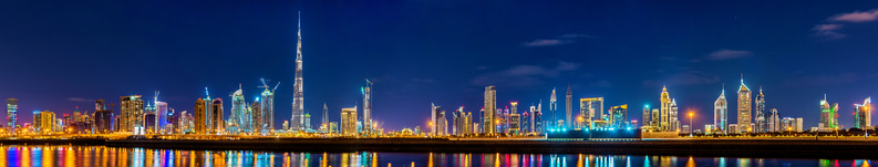 Night panorama of Dubai Downtown - the UAE